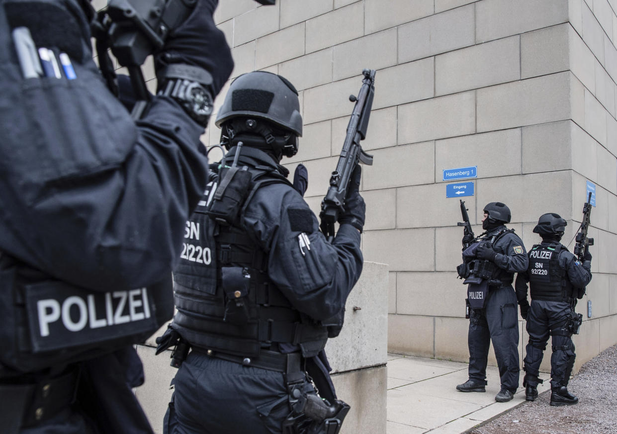 Police officers secure a synagogue in Dresden, after two people were gunned down in Halle in a anti-Semitic attack (Picture: AP)