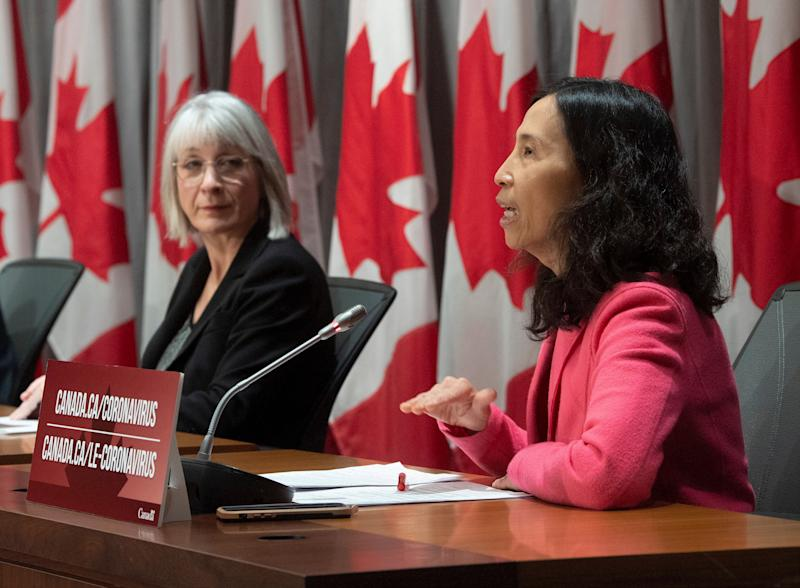 Minister of Health Patty Hajdu looks on as Chief Public Health Officer Theresa Tam responds to a question during a news conference in Ottawa on April 2, 2020. (Photo: Adrian Wyld/CP)