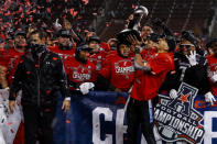 Cincinnati quarterback Desmond Ridder holds the trophy following the American Athletic Conference championship NCAA college football game against Tulsa, Saturday, Dec. 19, 2020, in Cincinnati. Cincinnati won 27-24. (AP Photo/Aaron Doster)