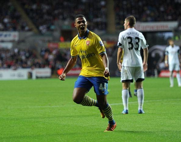 Serge Gnabry celebrates after scoring during the Barclays Premier League match between Swansea and Arsenal at Liberty Stadium on September 28, 2013 in Swansea, Wales. (Getty Images)