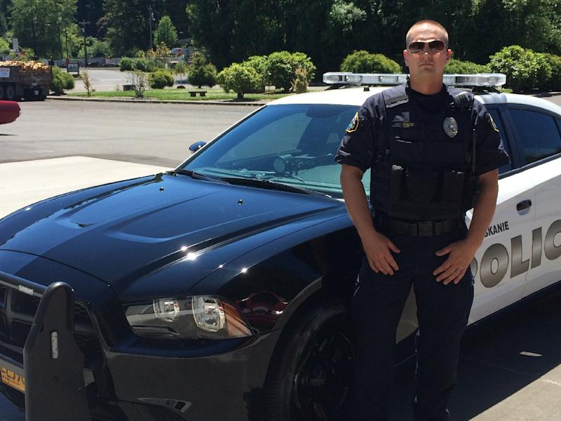 Officer Alex Stone, pictured in Clatskanie, Oregon, told AFP that he has received death threats from the local community and been racially abused since he and officer Zack Gibson filed a complaint earlier this summer (AFP Photo/)