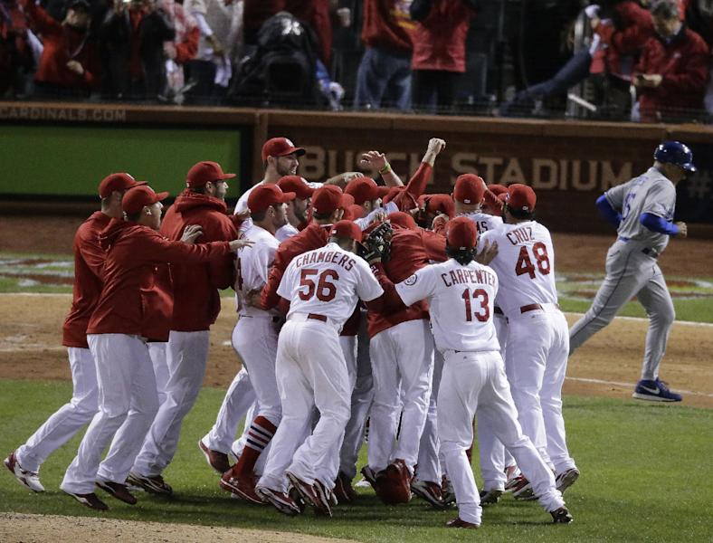 The St. Louis Cardinals celebrate after Game 6 of the National League baseball championship series against the Los Angeles Dodgers, Friday, Oct. 18, 2013, in St. Louis. The Cardinals won 9-0 to win the series. (AP Photo/Chris Carlson)