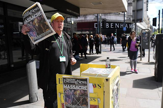 <p>A Manchester Evening News vendor sells newspapers showing headlines from the terrorist attack on May 23, 2017 in Manchester, England. (Leon Neal/Getty Images) </p>