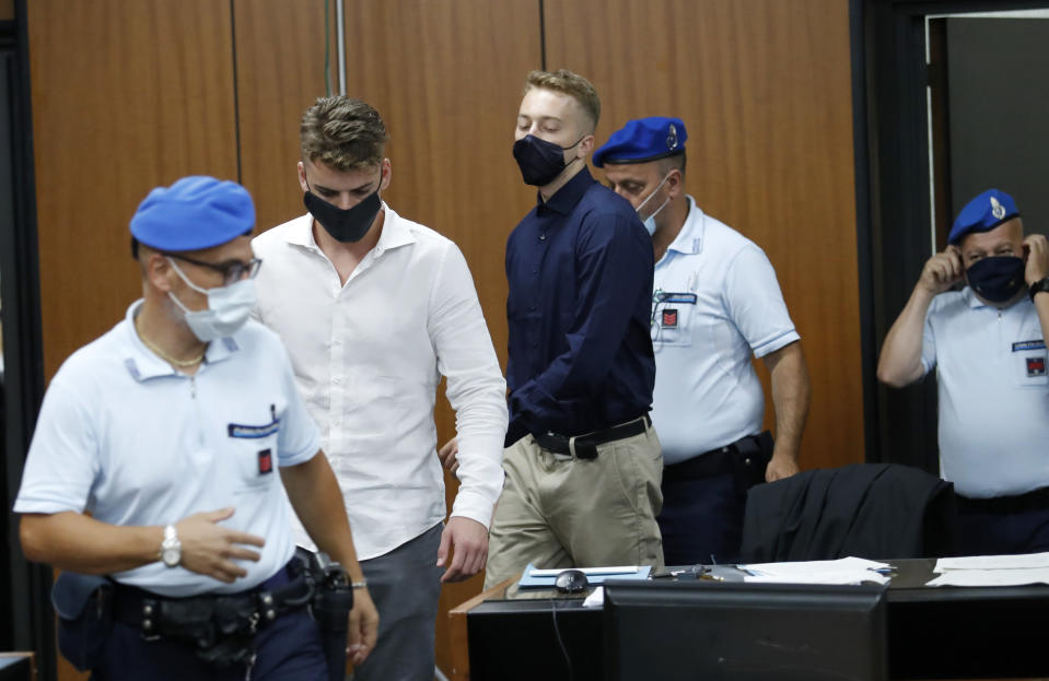 Gabriel Natale-Hjorth, second from left, and Finnegan Lee Elder, from California, arrive in court for a hearing in their trial where they are accused of slaying a plainclothes Carabinieri officer while on vacation in Italy last summer, in Rome, Wednesday, Sept. 16, 2020. (Remo Casilli/Pool Photo via AP)