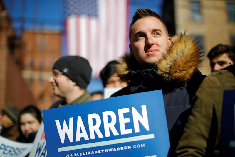Supporters wait for U.S. Senator Elizabeth Warren (D-MA) at a rally to launch her campaign for the 2020 Democratic presidential nomination in Lawrence, Massachusetts, U.S., February 9, 2019. REUTERS/Brian Snyder