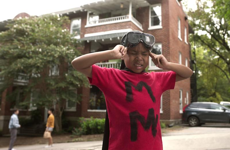 RAISING DION, in background, from left: Jason Ritter, Alisah Wainwright; front: Ja'Siah Young, (Season 1, aired Oct. 4, 2019). photo: Netflix / Courtesy Everett Collection