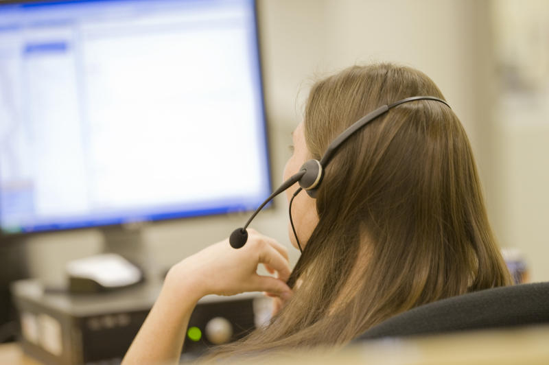 The Women's Center in Wisconsin, US was subjected to prank calls, clogging up their hotline which helps victims and survivors of domestic abuse. Pictured is a stock image of a female call centre worker.