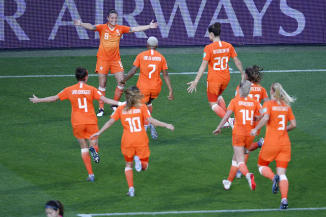 Netherlands' players celebrate their first goal during the Women's World Cup round of 16 soccer match between the Netherlands and Japan at Roazhon Park, in Rennes, France, Tuesday, June 25, 2019. (AP Photo/Francois Mori)