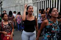 Relatives of inmates react outside a detention center of the Bolivarian National Intelligence Service (SEBIN), where a riot occurred, according to relatives, in Caracas, Venezuela May 16, 2018. REUTERS/Carlos Garcia Rawlins