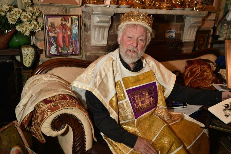 Paul Delprat, 76, the self-appointed Prince of the Principality of Wy, a micronation consisting of his home in the north Sydney suburb of Mosman, lounges on a sofa in his homemade kingdom