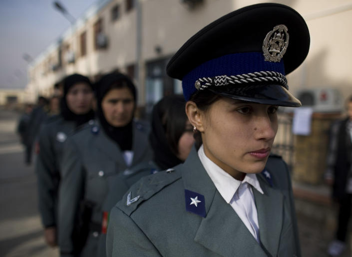 FILE --In this file photo taken Dec. 17, 2009, Afghan policewomen arrive to a graduation ceremony after eight weeks of training at a police academy in Kabul, Afghanistan. Gunmen shot and wounded the top female police officer in the troubled Helmand province Sunday, Sept. 15, 2013, just months after her predecessor was killed, officials said. It was the latest in a series of attacks on prominent women in Afghanistan, where just 1 percent of the police force is female. (AP Photo/Dusan Vranic, File)