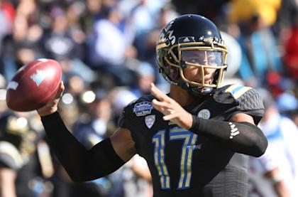 After accounting for 36 TDs in 2013, UCLA's Brett Hundley is a popular pick to win the Heisman. (AP)
