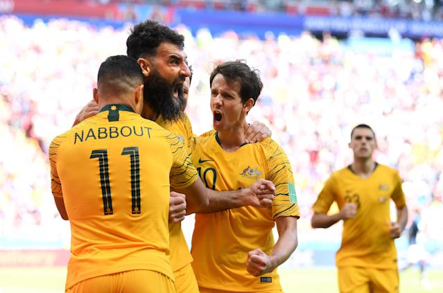 <p>Roo Beauty! Australia's players come together to celebrate their equaliser (getty) </p>