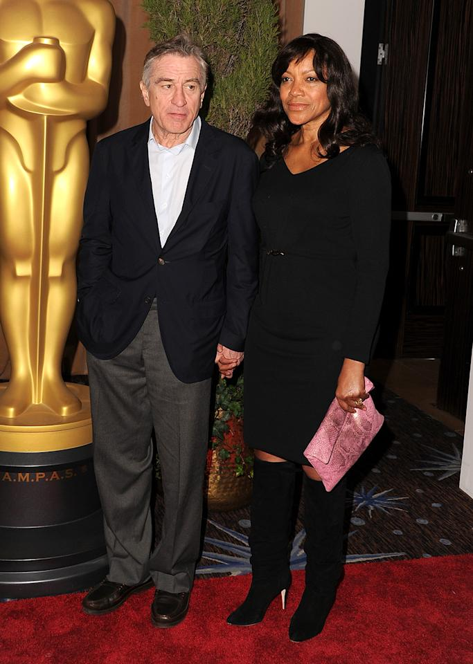 Robert De Niro (L) and Grace Hightower attend the 85th Academy Awards Nominees Luncheon at The Beverly Hilton Hotel on February 4, 2013 in Beverly Hills, California.  (Photo by Steve Granitz/WireImage)