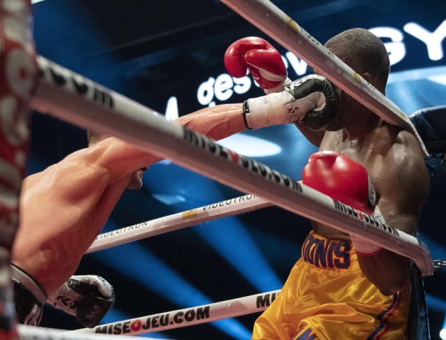 Oleksandr Gvozdyk, of Ukraine, lands a knockout punch to Adonis Stevenson, of Canada, to win the WBC light heavyweight championship boxing bout Saturday, Dec. 1, 2018, in Quebec City. (Jacques Boissinot/The Canadian Press via AP)