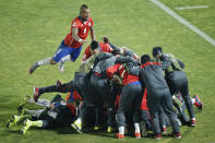 Chile's Arturo Vidal, left, jumps on top of teammates after Chile's Mauricio Isla scored against Uruguay during a Copa America quarterfinal soccer match at the National Stadium in Santiago, Chile, Wednesday, June 24, 2015. Chile won the match 1-0. (AP Photo/Silvia Izquierdo)