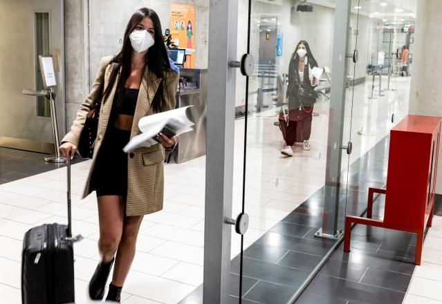A woman wears a mask at Larnaca International Airport, Cyprus. (Getty Images)