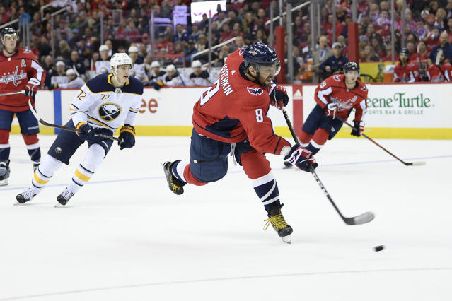 Washington Capitals left wing Alex Ovechkin (8), of Russia, shoots for a goal during the second period of an NHL hockey game in front of Buffalo Sabres right wing Tage Thompson (72), Saturday, Dec. 15, 2018, in Washington. (AP Photo/Nick Wass)