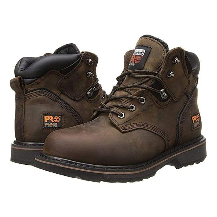 """<p><strong>Timberland</strong></p><p><a href=""""https://www.amazon.com/Timberland-PRO-Pitboss-Steel-Toe-Brown/dp/B000XEYS42/?tag=syn-yahoo-20&ascsubtag=%5Bartid%7C2139.g.19540212%5Bsrc%7Cyahoo-us"""" rel=""""nofollow noopener"""" target=""""_blank"""" data-ylk=""""slk:Shop Now"""" class=""""link rapid-noclick-resp"""">Shop Now</a></p><p><del>$127.50</del><strong><br>$93.95</strong></p><p>Timberland steel toe work boots check all the right boxes. The steel safety toe box is nice and roomy, shock-diffusion plates between the insole and outsole provide ease while standing on your feet all day, and they meet electrical hazard standards for protection from live electrical circuits. These Timbs perfectly straddle the line between toughness and comfort.</p>"""