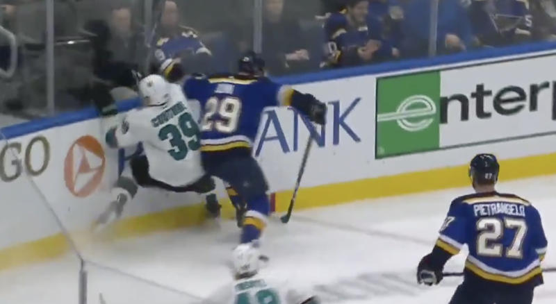 Sharks captain Logan Couture went into the end boards awkwardly while battling for a puck with Blues defenceman Vince Dunn on Tuesday. (Twitter//@NBCSSharks)
