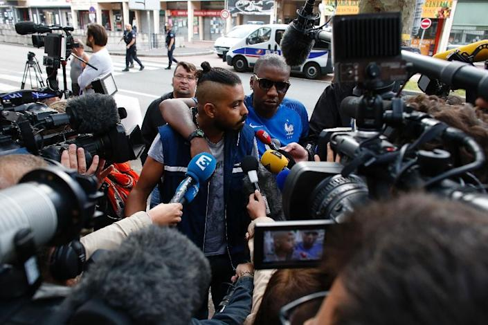 Relatives of victims (C) speak with journalists in front of the damaged Au Cuba Libre bar in Rouen, northern France, on August 6, 2016, after a fire broke out overnight in the bar during a birthday party (AFP Photo/Matthieu Alexandre)
