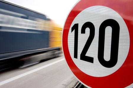 FILE PHOTO: A truck passes a 120 km/h (75 mph) speed limit sign on the A27 Autobahn near the northern German city of Bremen