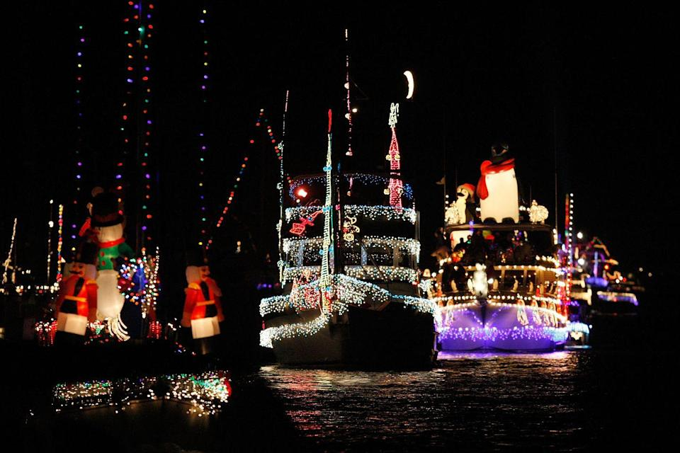 """<p>Every year, the residents of <a href=""""https://www.christmasboatparade.com/"""" rel=""""nofollow noopener"""" target=""""_blank"""" data-ylk=""""slk:Newport Beach"""" class=""""link rapid-noclick-resp"""">Newport Beach</a> and its surrounding areas fittingly takes their Christmas celebrations to the water. Over 100 boats — ranging from yachts to canoes — are decorated with countless Christmas lights. They sail around Newport Harbor for five nights, and at the end of the celebration, prizes are given to the best boats on the harbor. </p>"""