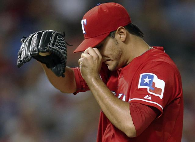 Texas Rangers' Martin Perez steps back onto the mound after giving up a two-run home run to Tampa Bay Rays' Evan Longoria during the third inning of an American League wild-card tiebreaker baseball game Monday, Sept. 30, 2013, in Arlington, Texas. (AP Photo/Tim Sharp)