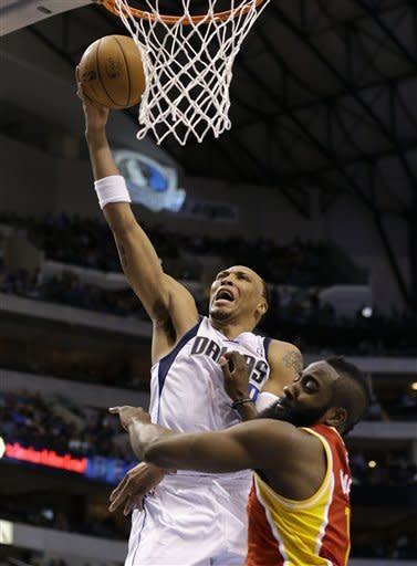 Dallas Mavericks' Shawn Marion (0) shoots over Houston Rockets' James Harden, bottom, in the second half of an NBA basketball game, Wednesday, March 6, 2013, in Dallas. Marion shared a team-high 22-points with Dirk Nowitzki in their 112-108 win. (AP Photo/Tony Gutierrez)