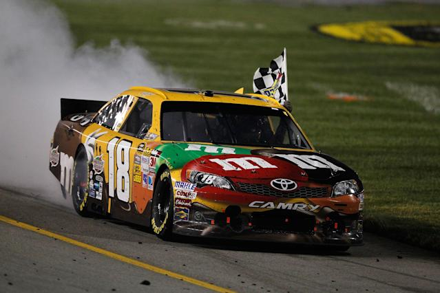 RICHMOND, VA - APRIL 28: Kyle Busch, driver of the #18 M&M's Ms. Brown Toyota, celebrates with a burnout and the checkered flag after winning the NASCAR Sprint Cup Series Capital City 400 at Richmond International Raceway on April 28, 2012 in Richmond, Virginia. (Photo by Streeter Lecka/Getty Images)
