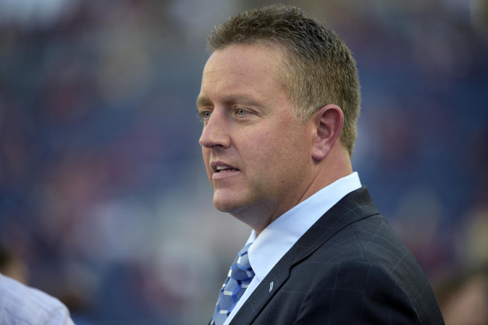 ESPN broadcaster Kirk Herbstreit watches warmups before an NCAA college football game between Florida State and Mississippi in Orlando, Fla., Monday, Sept. 5, 2016. Florida State won 45-34. (AP Photo/Phelan M. Ebenhack)
