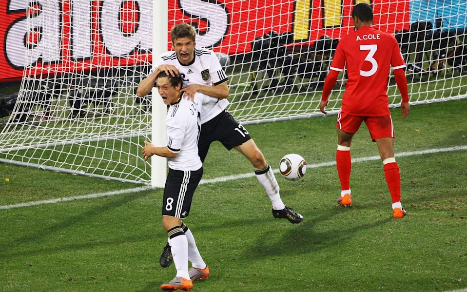 Thomas Mueller of Germany (up) celebrates scoring with Mesut Oezil - Getty Images