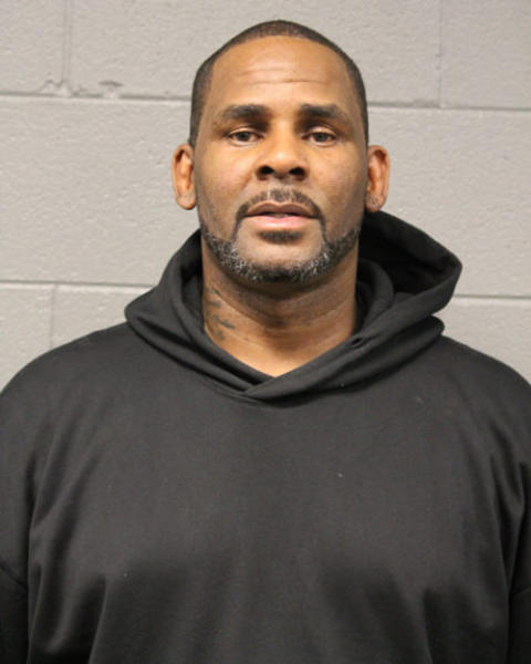 In this photo taken and released by the Chicago Police Dept., Friday, Feb. 22, 2019, R&B singer R. Kelly is photographed during booking at a police station in Chicago, Il. R. Kelly, the R&B star who has been trailed for decades by allegations that he violated underage girls and women and held some as virtual slaves, is due in court Saturday after being charged with aggravated sexual abuse involving four victims, including at least three between the ages of 13 and 17. (Chicago Police Dept. via AP)