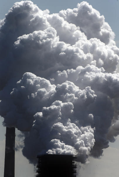 FILE - In this Monday, May 27, 2013 file photo, steam of a furnace pollutes the sky in Duisburg, Germany. The European Union says it will miss its targets for reducing planet-warming greenhouse gases by 2030 unless member states make a greater effort than they have so far. (AP Photo/Frank Augstein)
