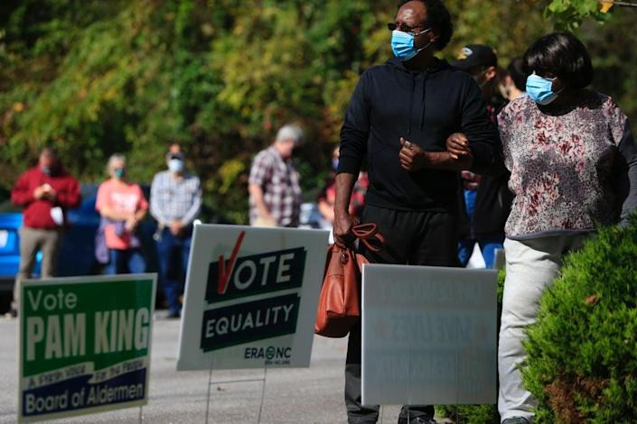 People Cast Ballots On First Day Of Early Voting In North Carolina