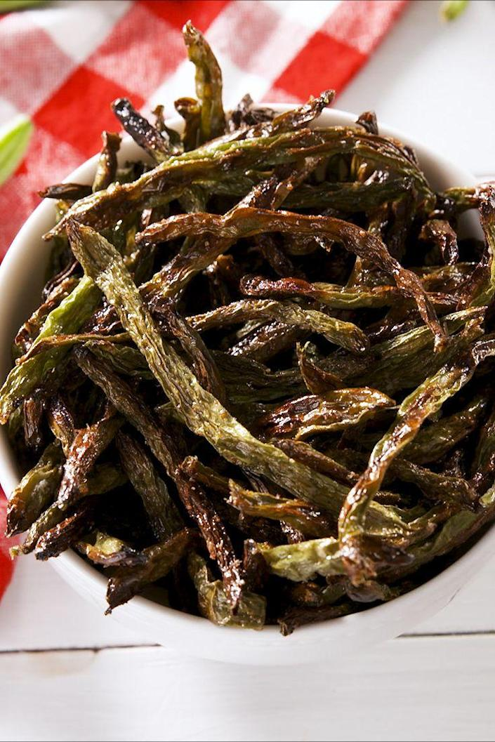 """<p>These get <em>perfectly </em>crunchy in the oven.</p><p>Get the recipe from <a href=""""https://www.delish.com/cooking/recipe-ideas/a27722071/green-bean-chips-recipe/"""" rel=""""nofollow noopener"""" target=""""_blank"""" data-ylk=""""slk:Delish"""" class=""""link rapid-noclick-resp"""">Delish</a>.</p>"""