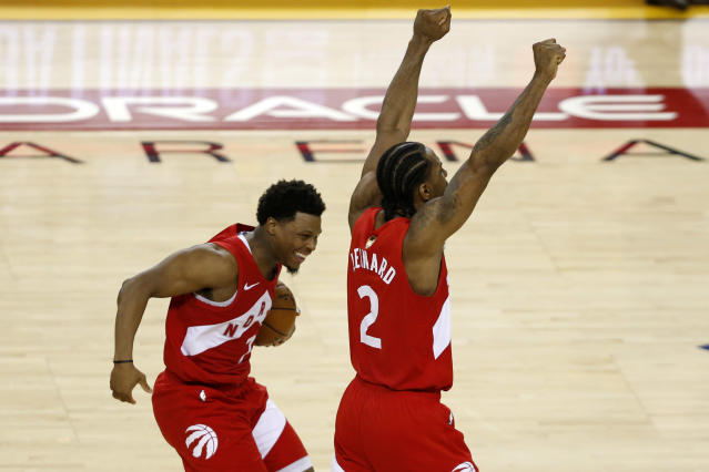 Raptors teammates Kyle Lowry and Kawhi Leonard celebrate the franchise's first-ever championship. (Getty Images)