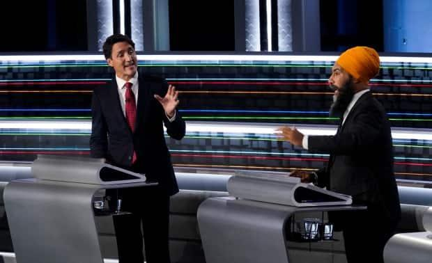 Liberal Leader Justin Trudeau, left, and NDP Leader Jagmeet Singh, take part in the federal election English-language Leaders debate in Gatineau, Que., on Thursday, Sept. 9, 2021. (Adrian Wyld/Canadian Press - image credit)