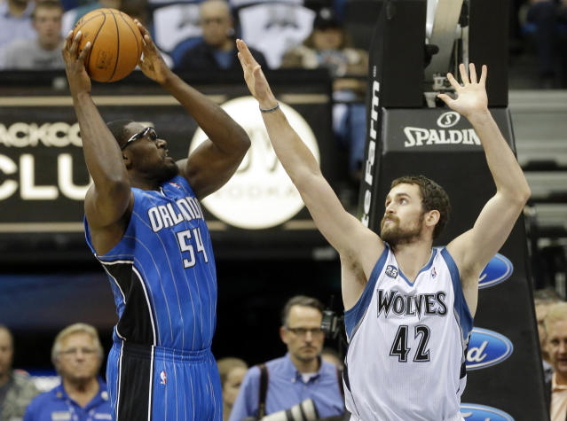 Orlando Magic's Jason Maxiell (54) prepares to shoot as Minnesota Timberwolves' Kevin Love, right, defends in the first quarter of an NBA basketball game, Wednesday, Oct. 30, 2013 in Minneapolis. (AP Photo/Jim Mone)