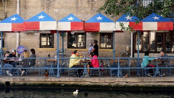 PHOTO: Diners eat at a restaurant on the River Walk, March 3, 2021, in San Antonio. (Eric Gay/AP)