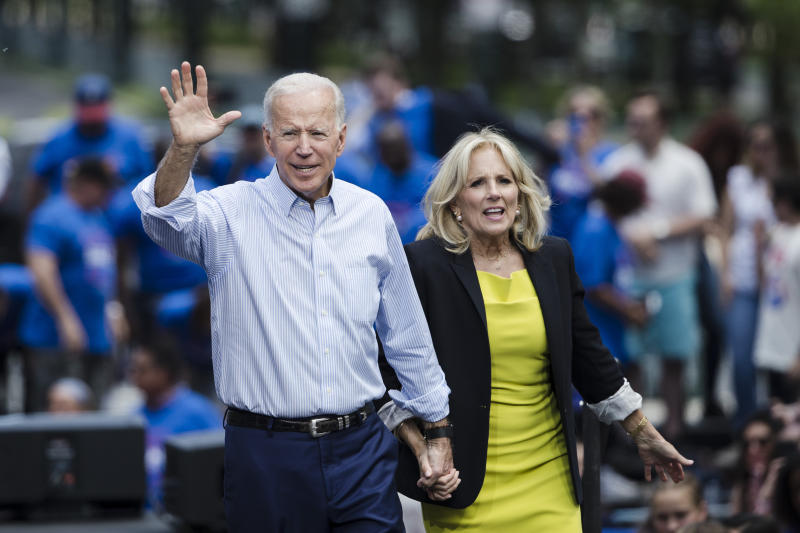 Democratic presidential candidate and former Vice President Joe Biden accompanied by his wife, Jill, waves during a campaign rally at Eakins Oval in Philadelphia in May. (Photo: Matt Rourke/AP)