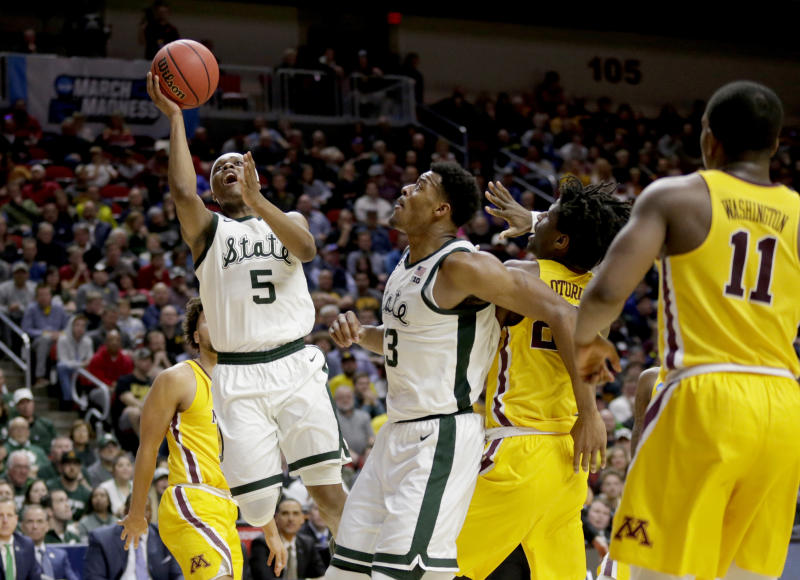 Michigan State's Cassius Winston (5) goes to the basket during the second half of a second round men's college basketball game against Minnesota in the NCAA Tournament, in Des Moines, Iowa, Saturday, March 23, 2019. (AP Photo/Nati Harnik)