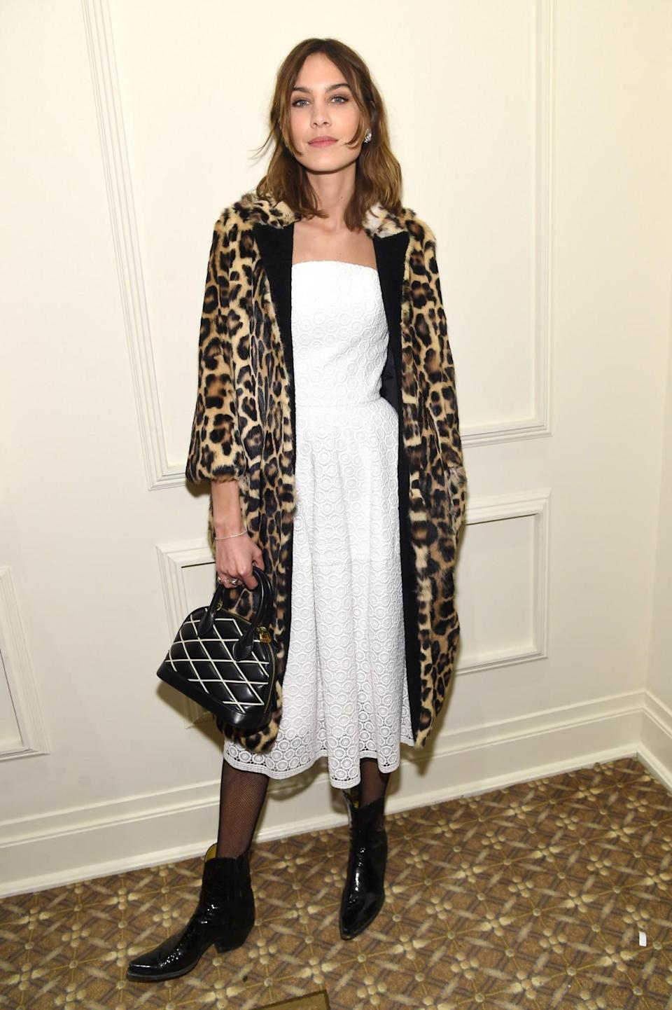 <p>Alexa Chung was dressed in a strapless white dress, patent ankle boots and a stand-out leopard print coat. <i>[Photo: Getty]</i> </p>