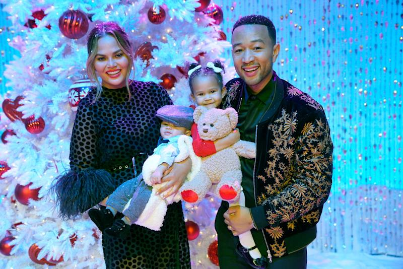 Model Chrissy Teigen, singer John Legend and their two children, photographed in 2018 [Photo: Getty]