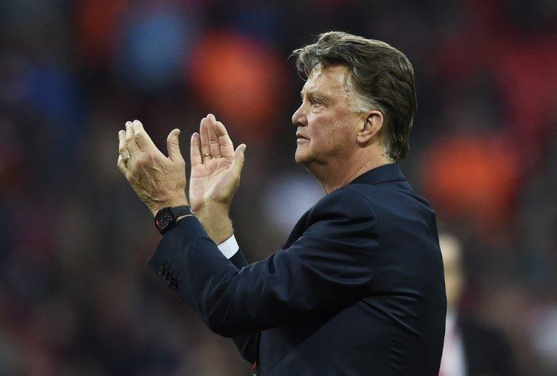 Manchester United manager Louis Van Gaal applauds the fans after winning the FA Cup - Reuters