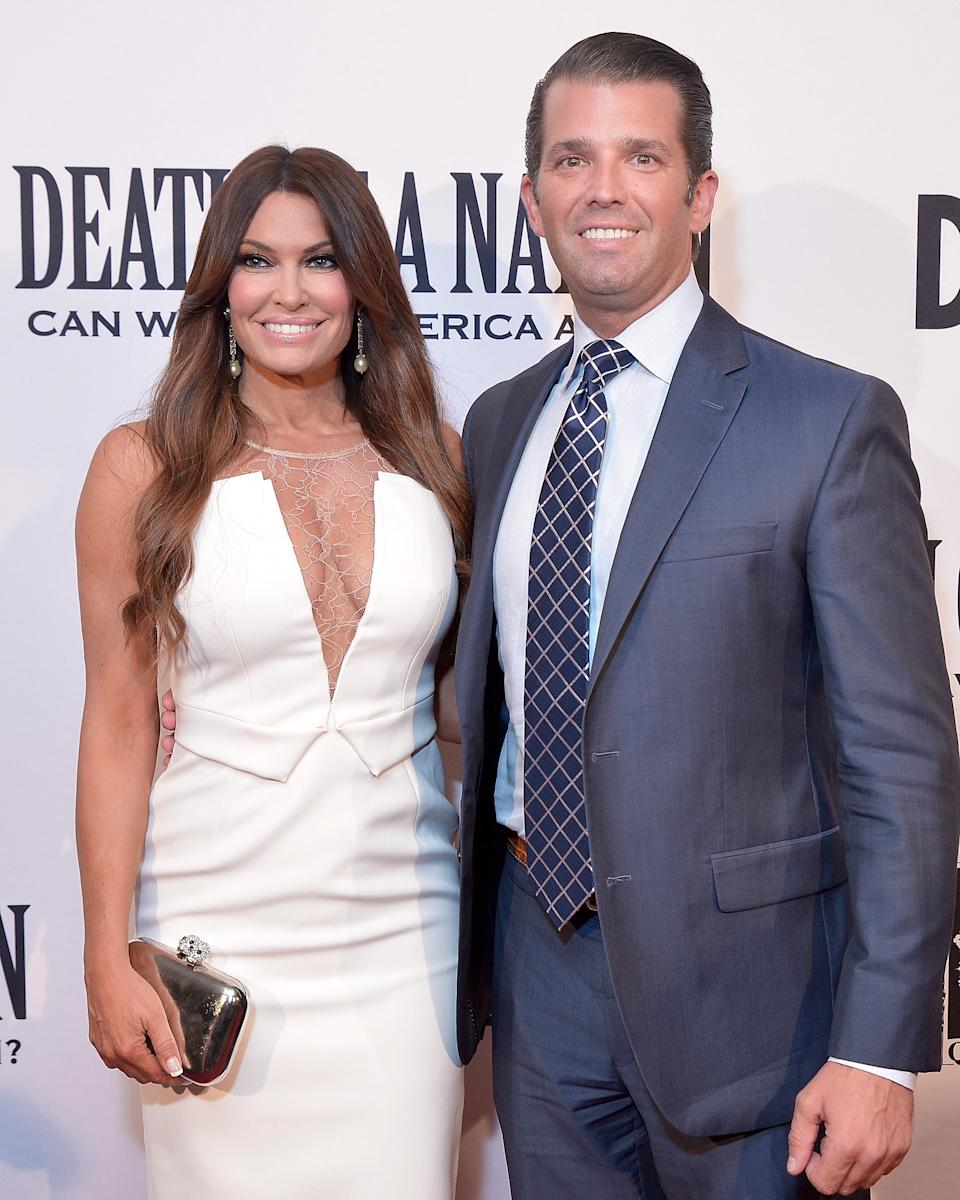 Kimberly Guilfoyle (pictured with boyfriend Donald Trump Jr. in August) hit the beach for her holiday greeting. (Photo: Shannon Finney/Getty Images)