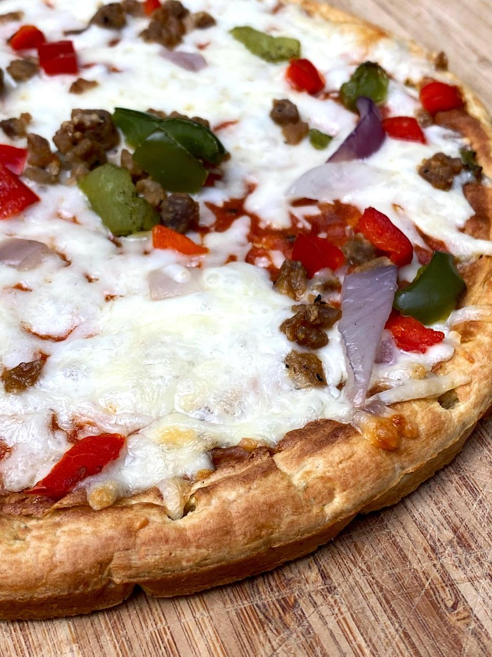 <p>When I tried a bite of the Banza Supreme pizza, (before I realized it wasn't vegan!), I liked the little spicy kick it had from the Beyond Meat sausage crumbles. Even my meat-eating husband couldn't tell it wasn't real meat. And again, the crust was yummy, chewy on the inside with a slightly crispy outside. This is just what you'd expect from a frozen pizza, but it's a great option for those looking to avoid meat.</p>