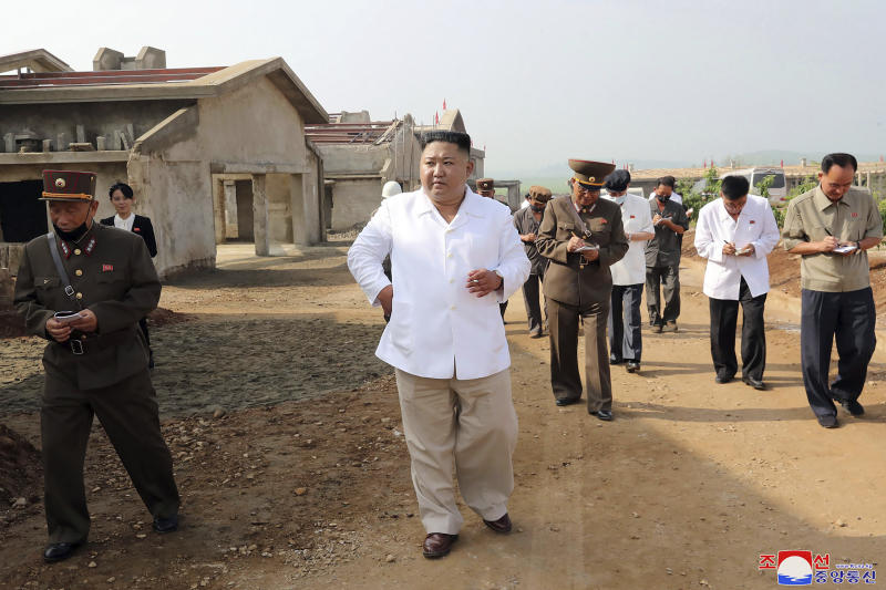 """In this undated photo provided on Thursday, July 23, 2020 by the North Korean government, North Korean leader Kim Jong Un, center, visits a new chicken farm being built in Hwangju County, North Korea. Independent journalists were not given access to cover the event depicted in this image distributed by the North Korean government. The content of this image is as provided and cannot be independently verified. Korean language watermark on image as provided by source reads: """"KCNA"""" which is the abbreviation for Korean Central News Agency. (Korean Central News Agency/Korea News Service via AP)"""