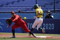 Australia's Leah Parry (44) is safe at first base as United States' Valerie Arioto (20) reaches for the throw in the third inning of a softball game at the 2020 Summer Olympics, Sunday, July 25, 2021, in Yokohama, Japan. (AP Photo/Sue Ogrocki)