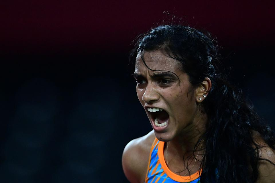 TOPSHOT - India's P. V. Sindhu reacts after a point against China's He Bingjiao in their women's singles badminton bronze medal match during the Tokyo 2020 Olympic Games at the Musashino Forest Sports Plaza in Tokyo on August 1, 2021. (Photo by Pedro PARDO / AFP) (Photo by PEDRO PARDO/AFP via Getty Images)